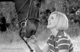 happy woman with her horse in black and white