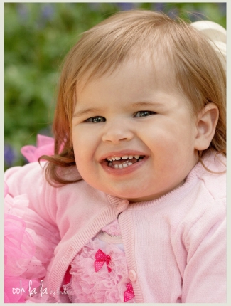 smiling baby dressed in pink