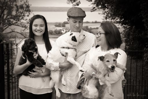 black and white family portrait with pet dogs