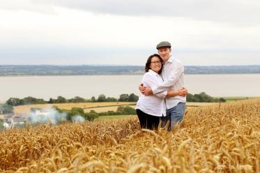 portrait of a couple in the fields, beautiful landscape
