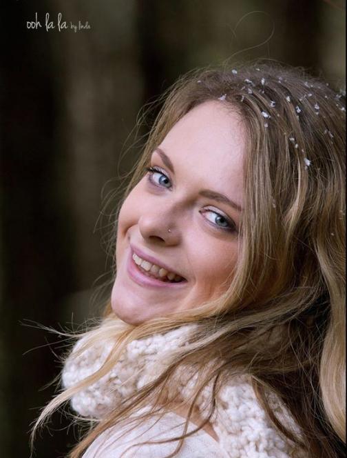 photograph of teenage girl outdoors.