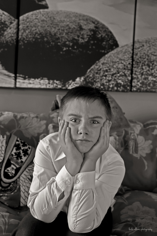 black and white portrait of boy scowling