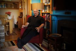 portrait of man sitting in armchair at home