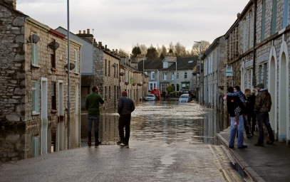 Flooded Kendal street and homeowners