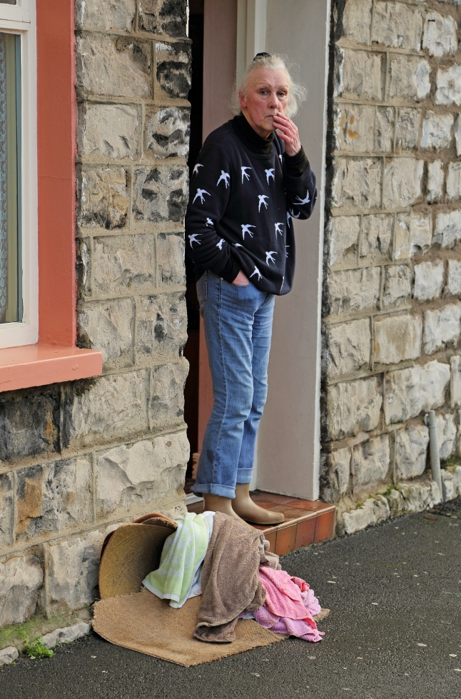 woman looking worried at flood damage