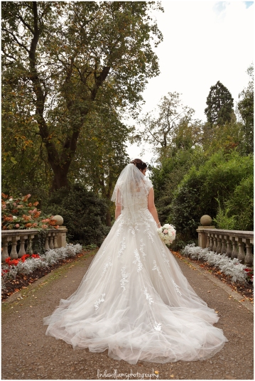 Back view of a beautiful wedding dress at Dewstow Gardens