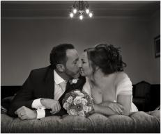 black-and-white-bride-groom-kissing