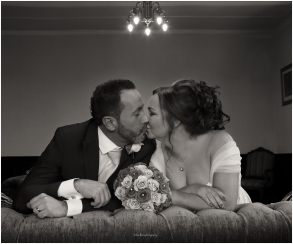 black-and-white-bride-groom-kissing