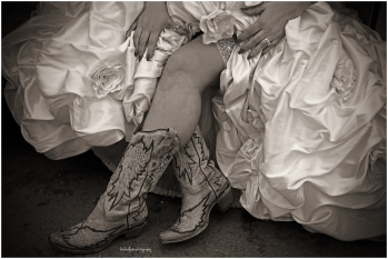Black and white of bride in cowboy boots