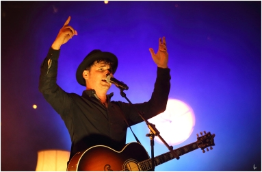 colour photograph of singer on stage
