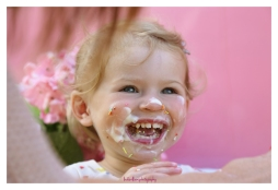little girl with ice cream on her face