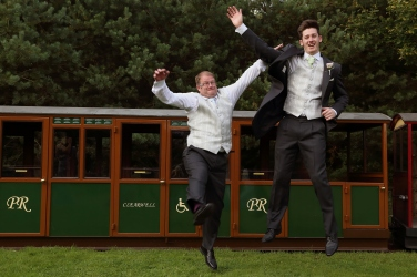 groomsmen having fun at wedding
