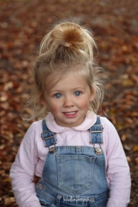 little girl in the autumn leaves