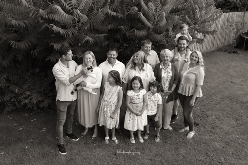 black and white photo of large family group