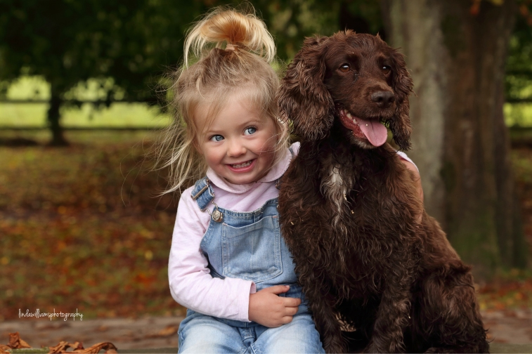 little girl with her dog