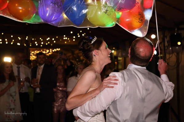bride and groom and balloons