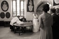 bride and groom signing register