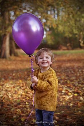 little boy with balloon