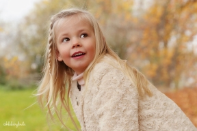 portrait of little girl in the autumn leaves