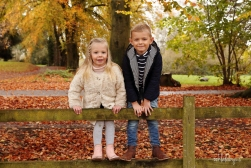 portrait of children in the autumn leaves Caldicot Castle