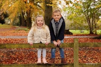 portrait of children in the autumn leaves Caldicot Castle