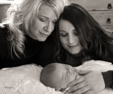 black and white photo of three generations