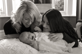 black and white family portrait of baby with mother and grandmother