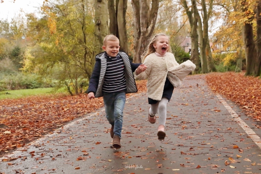 Photograph of two children running