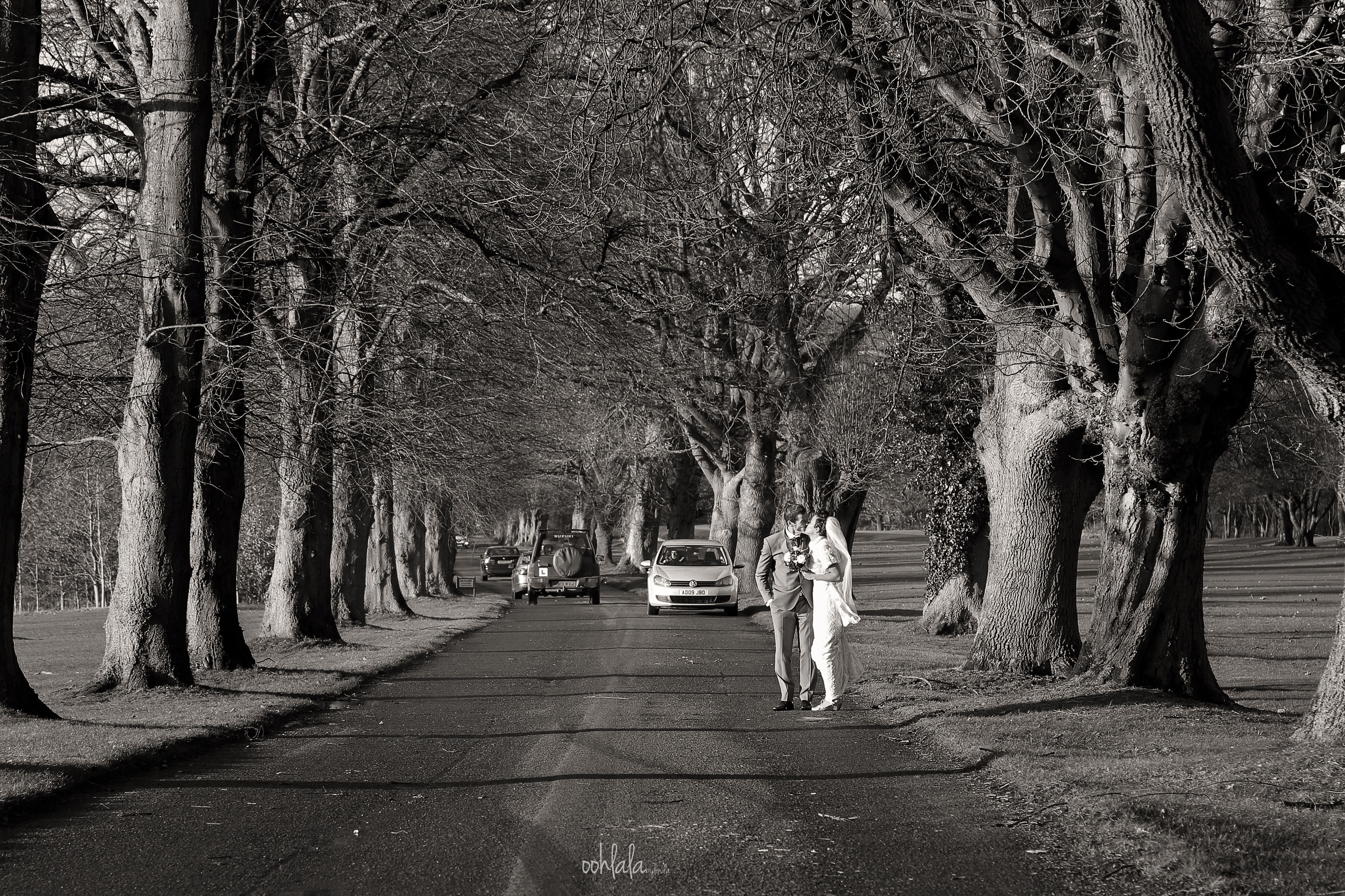 black and white photos of bride and groom in traffic
