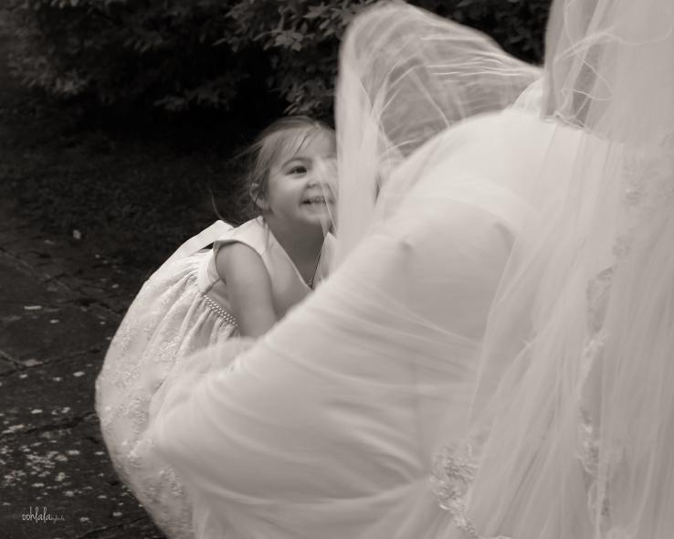 Bridesmaid with brides train
