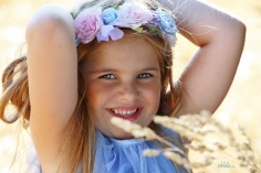 portrait of little girl with flowers in her hair