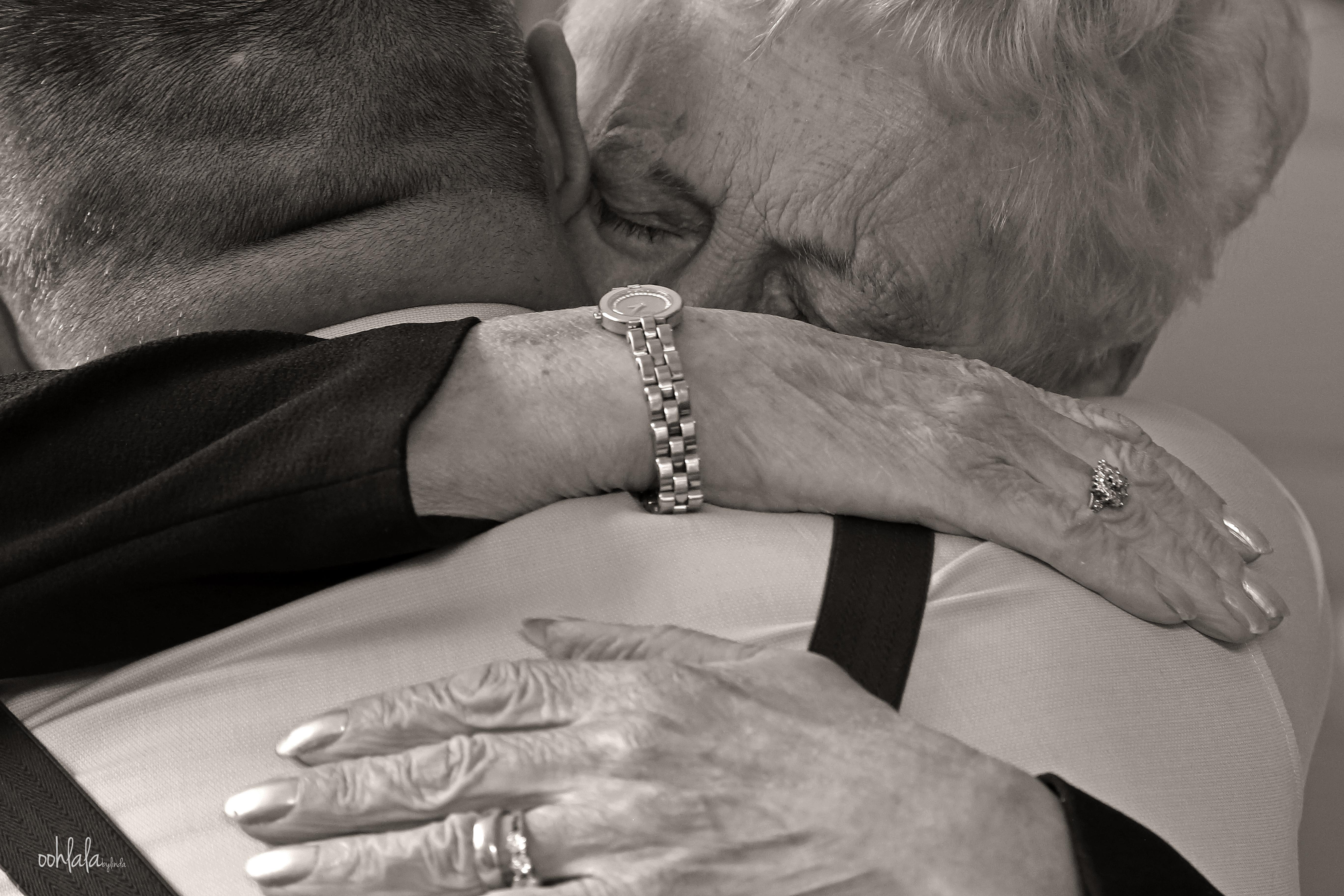 bride groom embracing grandmother