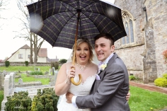 Bride and groom with umbrella