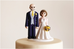 beautiful cake topper made by Artlocke Designs on a wedding cake