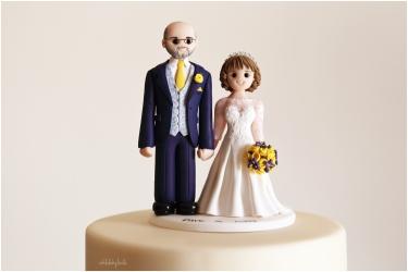 beautiful cake topper made by Artlocke Designs on a wedding cake