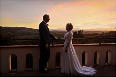 wedding photograph of bride and groom looking at each other in the sunset