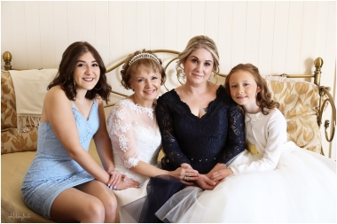 family group photograph taken of bride with daughters and granddaughters at Caer Llan