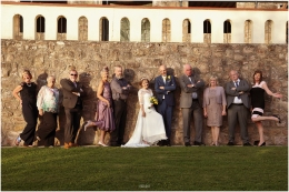 wedding guests pose for fun relaxed photograph at Chepstow Wedding held at caer Llan