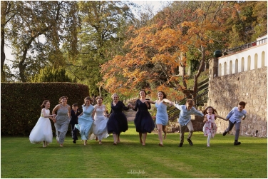 wedding guests run for photographer at Caer Llan