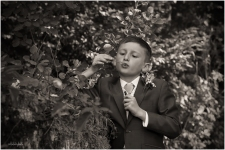 black and white portrait of page boy blowing bubbles at a Chepstow wedding