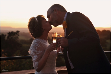 bride and groom kiss and toast just married at Caer Llan