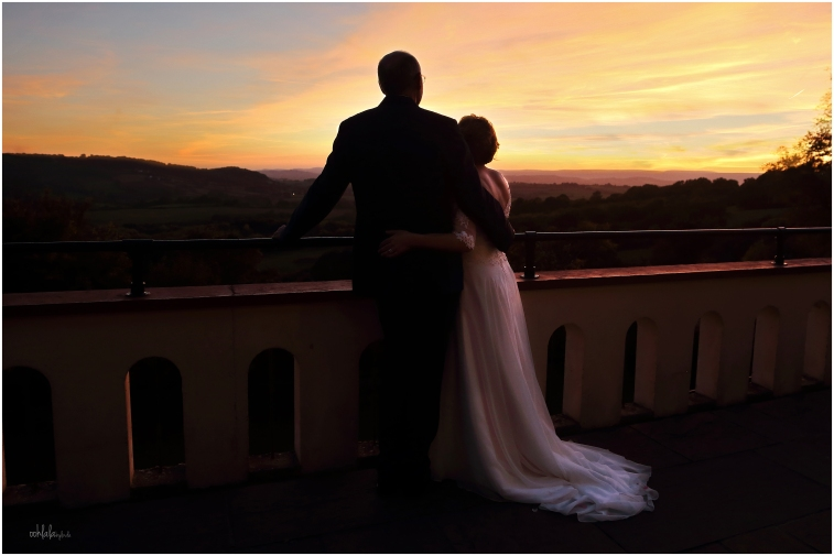 bride and groom just married and watching the sunset for a romantic photograph over the Monmouthshire countryside