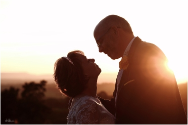 couple looking at each other in the sunset at Caer Llan near Monmouth