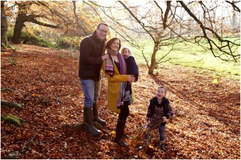 photograph of family in the autumn leaves