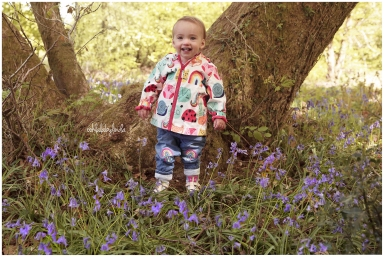 little girl smiling in the bluebells Wentwood