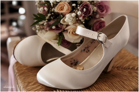 brides shoes and bouquet at home in Undy