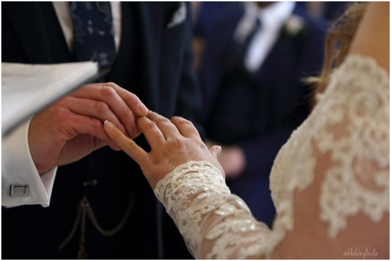 bride puts ring on brides finger Redwick church
