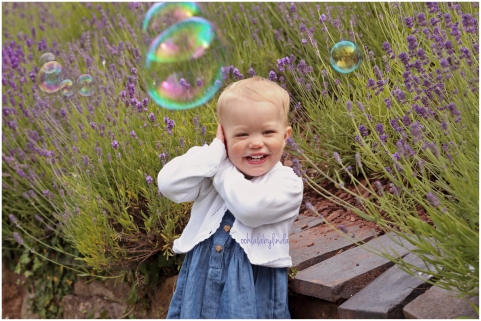 little girl posing in the garden with bubbles