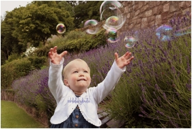 little girl chasing bubbles