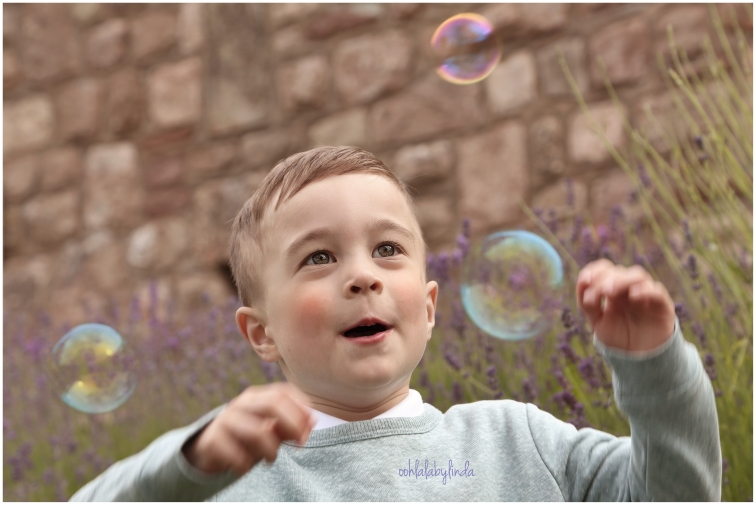 little boy playing with bubbles